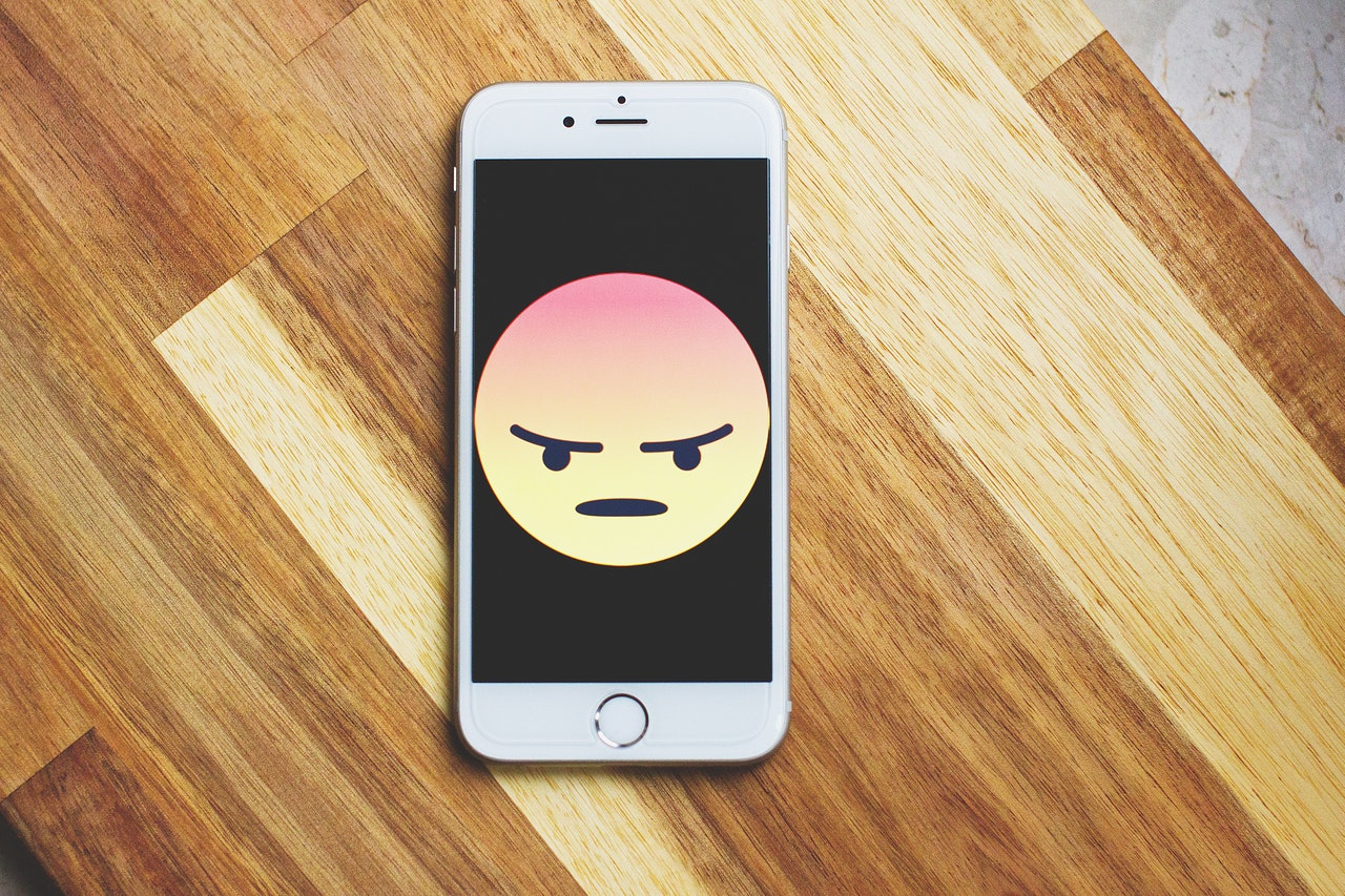 angry emoji on phone - acupuncture for anger management
